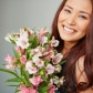 young-woman-smiling-with-a-bouquet_1098-659